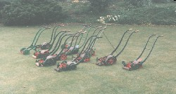 Twelve hand mowers made between 1855-1900